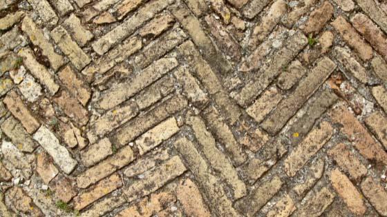 Ancient Roman road laid with brick in a herringbone design