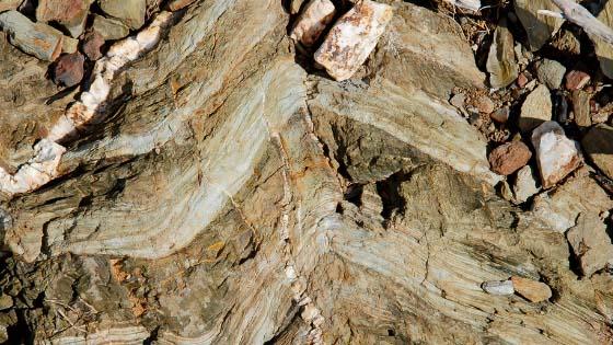 Chevron folds in layered sedimentary rock